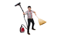 Man with vacuum cleaner and broom Royalty Free Stock Photos