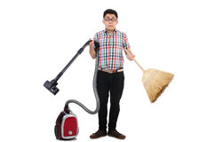 Man with vacuum cleaner and broom Royalty Free Stock Images