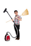 Man with vacuum cleaner and broom Royalty Free Stock Photography