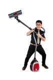 Man with vacuum cleaner Stock Photo