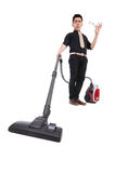 Man with vacuum cleaner Stock Images