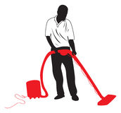 Man vacuuming. A silhouette on a man vacuuming Royalty Free Stock Photos