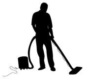 Man vacuuming. A silhouette on a man vacuuming Royalty Free Stock Image