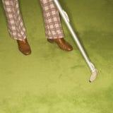 Man vacuuming rug. Royalty Free Stock Images