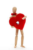 Man with valentine. A man offers a huge red satin heart with a diamond Royalty Free Stock Photography