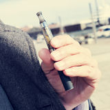 Man vaping with an electronic cigarette outdoors Royalty Free Stock Images