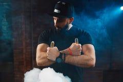 Man vaping an electronic cigarette Royalty Free Stock Photo
