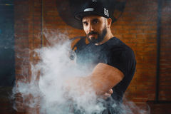 Man vaping an electronic cigarette Stock Images