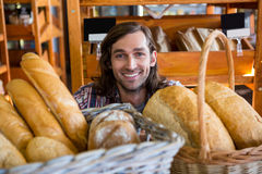 Man with a variety of breads Stock Photography