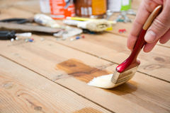 Man varnishing a wood Royalty Free Stock Image