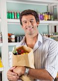 Man With Vegetable Bag In Grocery Store Stock Image