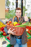 Man with vegetables holding thumnbs up Stock Photography