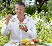 The man the vegetarian tastes salad Royalty Free Stock Photos