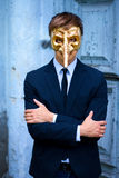 Man in the venetian mask. Businessman in the venetian gold mask with big nose Royalty Free Stock Image