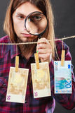 Man verify money cash. Currency exchange concept. Man worker check verify money cash. Payment hang on laundry line. Guy with loupe Stock Image