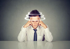 Man with vertigo. Young patient suffering from dizziness. Stock Images