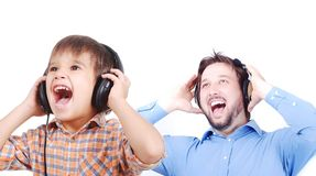 Man, very cute child and music Stock Photography