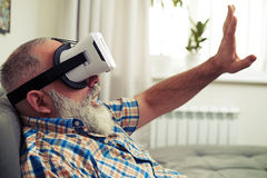 Man very excited using modern virtual reality headset glasses Stock Photography