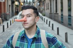 Man with a very long nose royalty free stock photography