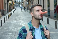 Man with a very long nose outdoors royalty free stock photos