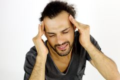 Man with very strong headache suffering Royalty Free Stock Photo