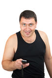 A man in a vest with a mobile phone Royalty Free Stock Photo