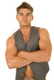 Man in vest no shirt arms folded smile Stock Image