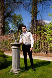 Man in Victorian clothing, pillar and sundial in t Stock Photography