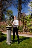 Man in Victorian clothing, shaft and sundial in th Royalty Free Stock Photos
