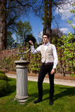 Man in Victorian clothing and sundial in the park Royalty Free Stock Photos