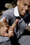 Man with victory fingers stock photos