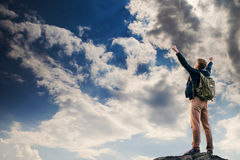 Man with victory gesture on the top of mountain Stock Photos