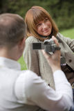Man with video camera filming Stock Image
