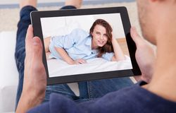 Man video chatting on digital tablet Stock Images