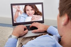Man video chatting on laptop Royalty Free Stock Photo