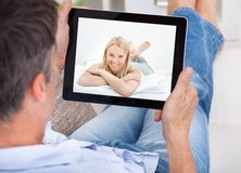 Man video chatting with woman Royalty Free Stock Image