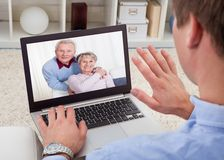 Man video conferencing on laptop Stock Photos