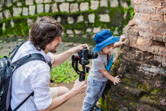 Man videographer and his son shoots video in the electronic stabilizer, steadycam To shoot at Po Nagar Cham Tovers. Digital techno Royalty Free Stock Photo