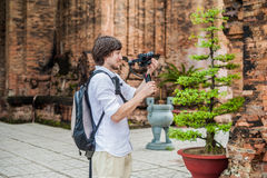 Man videographer shoots video in the electronic stabilizer, steadycam To shoot at Po Nagar Cham Tovers. Digital technology concept Royalty Free Stock Image