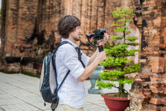 Man videographer shoots video in the electronic stabilizer, steadycam To shoot at Po Nagar Cham Tovers. Digital technology concept Royalty Free Stock Images