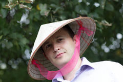 Man in vietnam hat in park Stock Photography