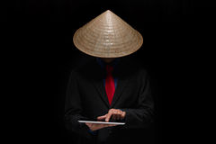 Man in Vietnamese conical hat Stock Photography