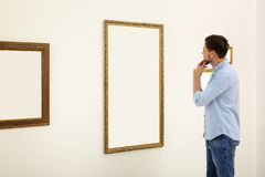 Man viewing exposition. In modern art gallery stock image
