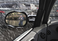 Man viewing himself in automobile sideview mirror Royalty Free Stock Photos