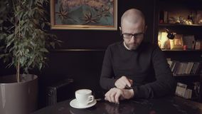 Man viewing the information on his smart watches. stock video footage