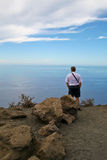 Man viewing the sea Stock Image
