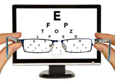 Man is viewing to eye examination chart Stock Photography