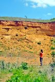 Man is viewing to a historic gravel pit in a natural habitat of sand martin flight of flock Riparia riparia stock photo