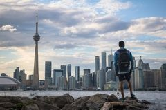 Wide view of man and Toronto skyline royalty free stock images