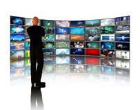 Man viewing video displays Royalty Free Stock Image